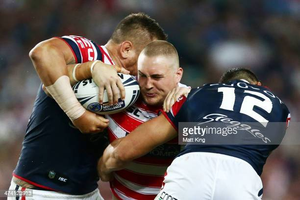 Gil Dudson of the Warriors is tackled during the NRL World Club Challenge match between the Sydney Roosters and the Wigan Warriors at Allianz Stadium...
