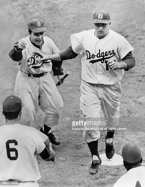 Gil Hodges of the Brooklyn Dodgers celebrates as he crosses home plate during the 1955 World Series game against the New York Yankees The Dodgers won...