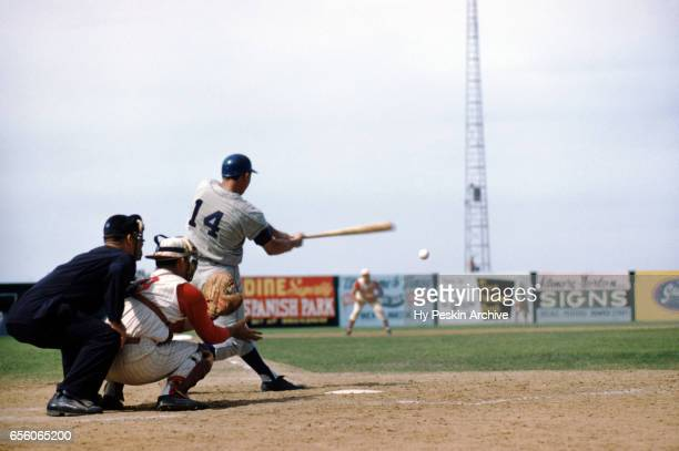Gil Hodges of the Los Angeles Dodgers swings at the pitch during an MLB Spring Training game against the Cincinnati Redlegs circa March 1959 in...