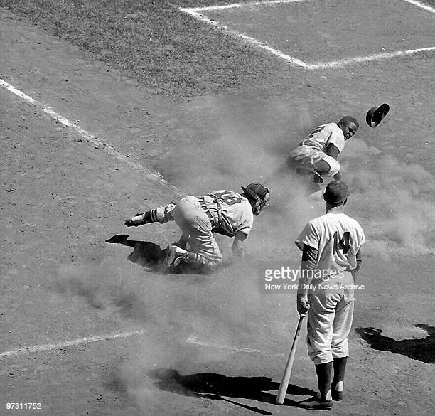 Gil Hodges stands aside watching the action as Burbink of the St. Louis Cardinals tags Jackie Robinson of the Brooklyn Dodgers to make the third out....