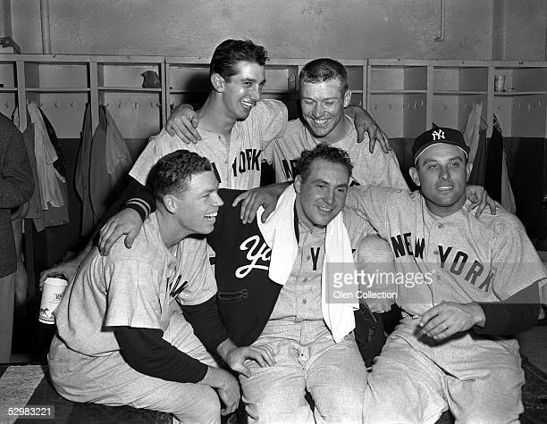 Gil McDougald Billy Martin Mickey Mantle Gene Woodling surround Jim McDonald of the New York Yankees after Game 5 of the World Series on October 4...
