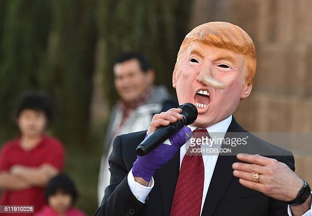 Gil Mobley wears a Donald Trump costume while singing a song he wrote about him in front of the Trump International Hotel in Las Vegas on February 23...