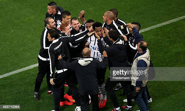 Gil of Corinthians celebrates scoring the first goal with his team during the match between Corinthians and Bahia for the Brazilian Series A 2014 at...