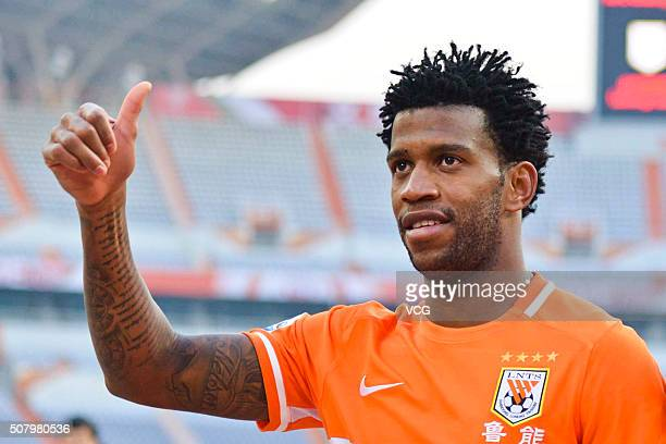 Gil of Shandong Luneng acknowledges the crowd after the 2016 AFC Champions League qualifying match between Shandong Luneng and Mohun Bagan at Jinan...