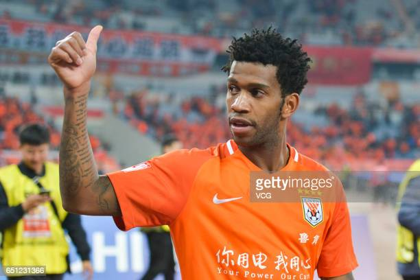 Gil of Shandong Luneng celebrates after winning the 2nd round match of CSL Chinese Football Association between Shandong Luneng and Guangzhou...