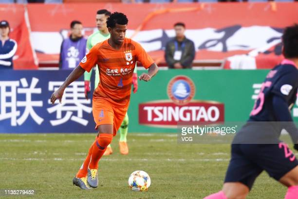 Gil of Shandong Luneng drives the ball during the AFC Champions League Group E match between Shandong Luneng and Kashima Antlers at Jinan Olympic...
