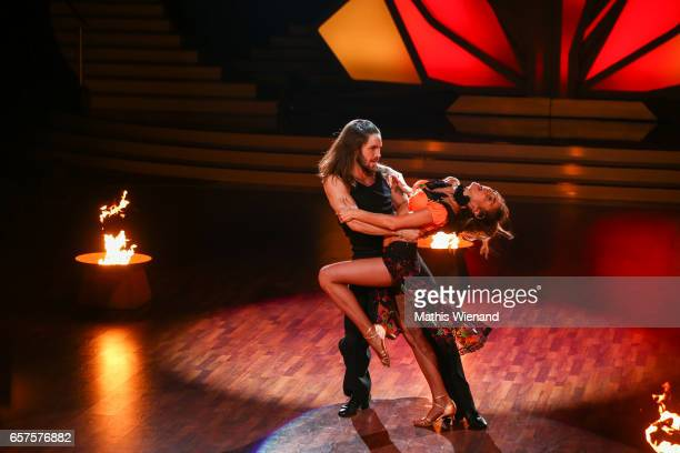 Gil Ofarim and Ekaterina Leonova perform on stage during the 2nd show of the tenth season of the television competition 'Let's Dance' on March 24...