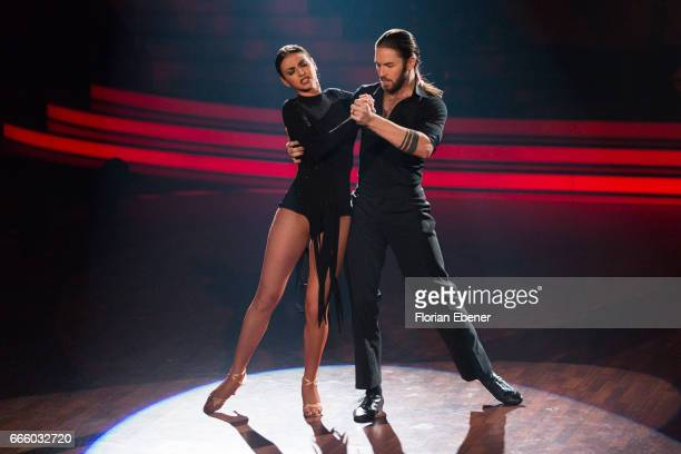 Gil Ofarim and Ekaterina Leonova perform on stage during the 4th show of the tenth season of the television competition 'Let's Dance' on April 7,...