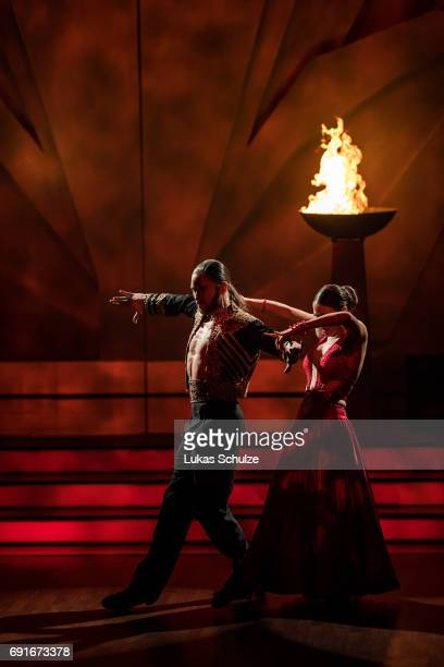 Gil Ofarim and Ekaterina Leonova perform on stage during the semi final of the tenth season of the television competition 'Let's Dance' on June 2,...