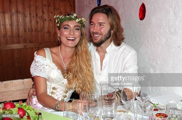 Gil Ofarim and his girlfriend Verena Brock attend the Dresscoded Hippie Wiesn 2014 at Golfclub Gut Thailing on August 28 2014 in Steinhoering near...