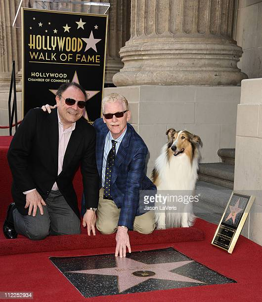 Gil Schwartz and Bill Geist attend Geist's induction into the Hollywood Walk of Fame on April 15 2011 in Hollywood California
