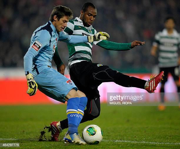 Gil Vicente's Brazilian goalkeeper Adriano Facchini vies with Sporting's forward Wilson Eduardo during the Portuguese league football match Gil...