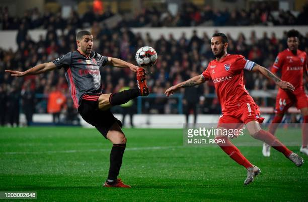 Gil Vicente's Portuguese defender Ruben Fernandes vies with Benfica's Moroccan midfielder Adel Taarabt during the Portuguese league football match...