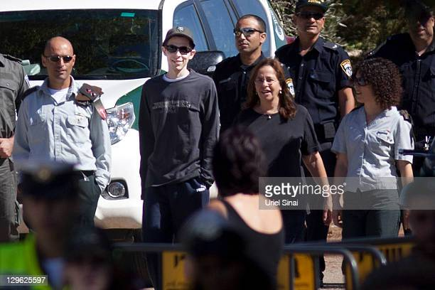 Gilad Shalit walks with his mother Aviva outside their home on October 19 2011 in Mitzpe Hila Israel Shalit was freed yesterday after being held...