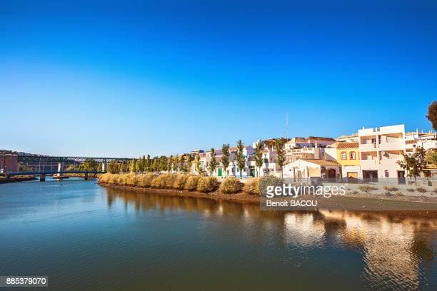 gilao edge of the river, tavira, algarve region, portugal - tavira imagens e fotografias de stock