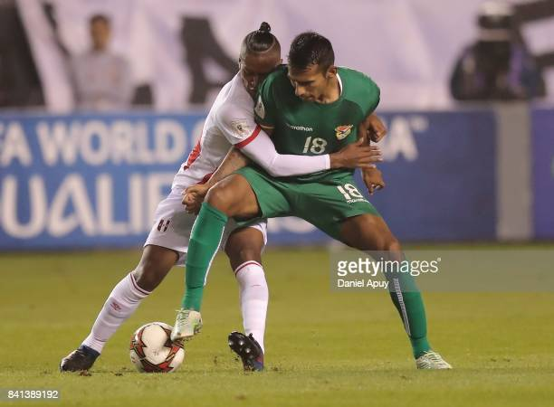 Gilbert Alvarez of Bolivia fights for the ball with Pedro Aquino of Bolivia during a match between Peru and Bolivia as part of FIFA 2018 World Cup...