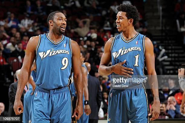 Gilbert Arenas and Nick Young of the Washington Wizards talk during the game against the New Jersey Nets on December 16 2010 at the Prudential Center...
