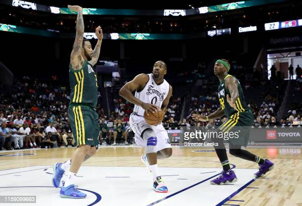 Gilbert Arenas of Enemies drives to the basket against Ball Hogs during week two of the BIG3 three on three basketball league at Spectrum Center on...