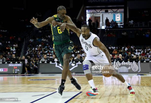 Gilbert Arenas of Enemies drives to the basket against Qyntel Woods of Ball Hogs during week two of the BIG3 three on three basketball league at...