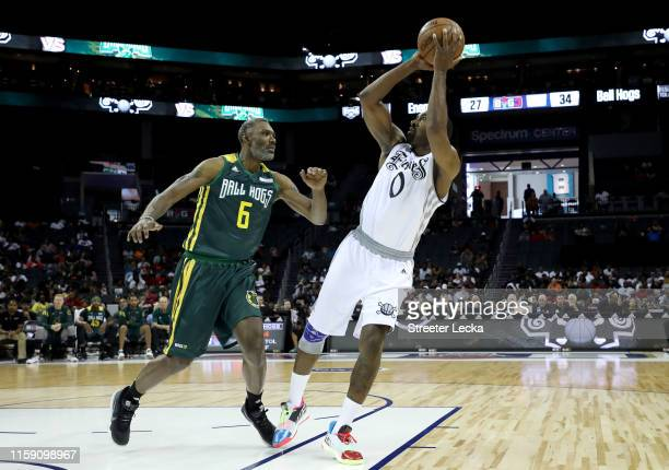 Gilbert Arenas of Enemies shoots over Qyntel Woods of Ball Hogs during week two of the BIG3 three on three basketball league at Spectrum Center on...
