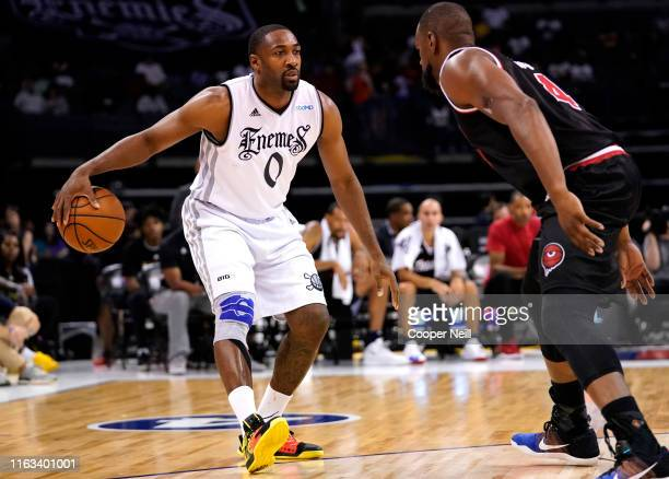 Gilbert Arenas of the Enemies drives past Sam Young of Trilogy during week five of the BIG3 three on three basketball league at Chesapeake Energy...
