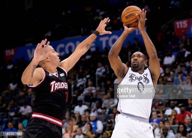 Gilbert Arenas of the Enemies takes a shot over Carlos Arroyo of Trilogy during week five of the BIG3 three on three basketball league at Chesapeake...