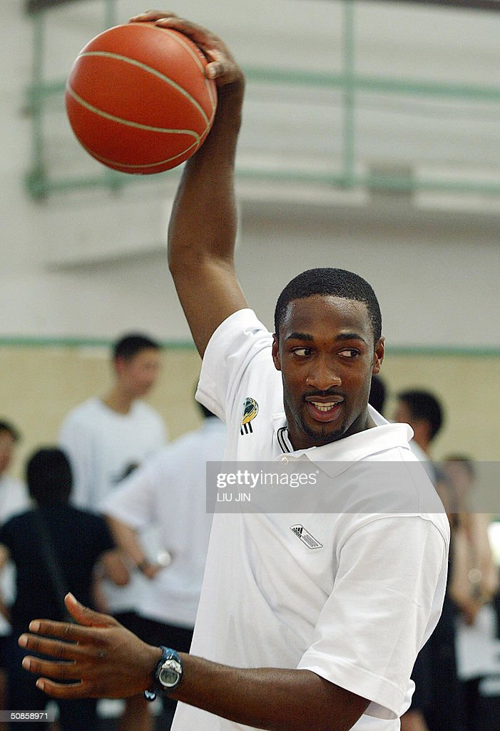 Gilbert Arenas of the NBA Washington Wizards team plays with a ball ahead the training session of the Adidas Basketball Superstar Camp in Shanghai, 20 May 2004. The camp features NBA players and professional coaches from the US, Europe and China to develop future generations of Basketball superstars. Fifty elite youth basketball players from China, Hong Kong, Australia, Philippines, Korea, Chinese Taipei, Singapore participate the four-day training event. AFP PHOTO/LIU Jin