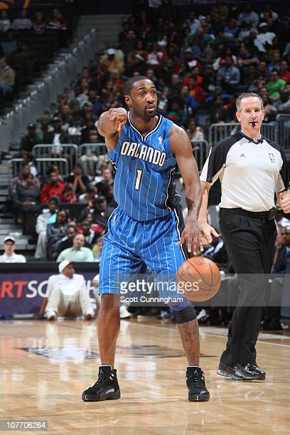 Gilbert Arenas of the Orlando Magic directs the offense against the Atlanta Hawks on December 20 2010 at Philips Arena in Atlanta Georgia NOTE TO...