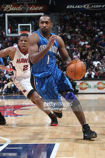 Gilbert Arenas of the Orlando Magic drives against Joe Johnson of the Atlanta Hawks on December 20 2010 at Philips Arena in Atlanta Georgia NOTE TO...