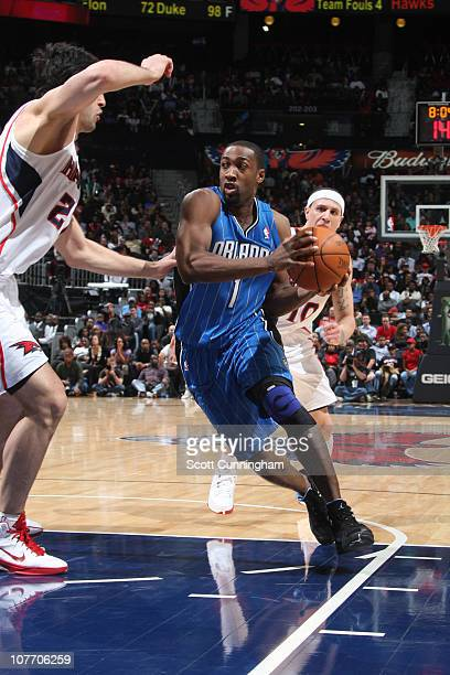 Gilbert Arenas of the Orlando Magic drives against Zaza Pachulia of the Atlanta Hawks on December 20 2010 at Philips Arena in Atlanta Georgia NOTE TO...