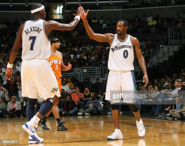 Gilbert Arenas of the Washington Wizards celebrates with teammate Andray Blatche during the game against the Phoenix Suns on November 8 2009 at the...