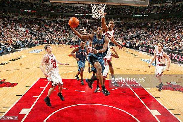 Gilbert Arenas of the Washington Wizards drives against Antonio Davis in Game two of the Eastern Conference Quarterfinals during the 2005 NBA...