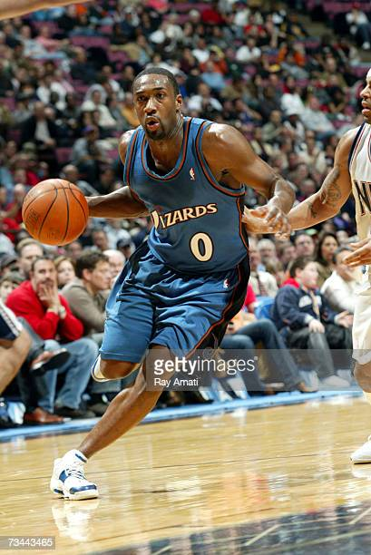 Gilbert Arenas of the Washington Wizards drives against the New Jersey Nets on February 27 2007 at Continental Airlines Arena in East Rutherford New...