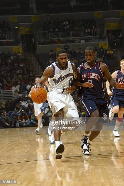 Gilbert Arenas of the Washington Wizards drives around Anthony Goldwire of the New Jersey Nets during the game at the MCI Center on March 31, 2004 in...