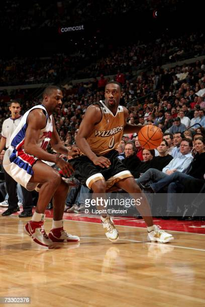 Gilbert Arenas of the Washington Wizards drives around Lindsey Hunter of the Detroit Pistons during the game at The Palace of Auburn Hills on January...
