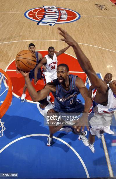 Gilbert Arenas of the Washington Wizards drives for a layup against Amir Johnson of the Detroit Pistons at the Palace of Auburn Hills on April 19...