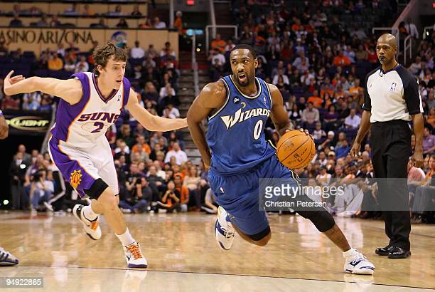 Gilbert Arenas of the Washington Wizards drives the ball past Goran Dragic of the Phoenix Suns during the NBA game at US Airways Center on December...