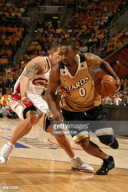 Gilbert Arenas of the Washington Wizards drives to the basket against Delonte West of the Cleveland Cavaliers during Game Two of the Eastern...