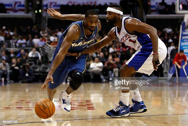Gilbert Arenas of the Washington Wizards drives to the basket as Baron Davis of the Los Angeles Clippers defends in the first half at Staples Center...