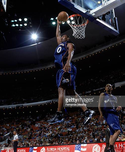 Gilbert Arenas of the Washington Wizards dunks the ball during the game against the Orlando Magic at the TD Waterhouse Centre on March 10 2004 in...