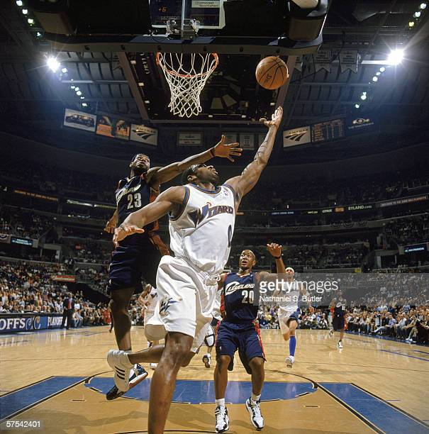 Gilbert Arenas of the Washington Wizards puts up the shot under pressure from LeBron James of the Cleveland Cavaliers in game four of the Eastern...