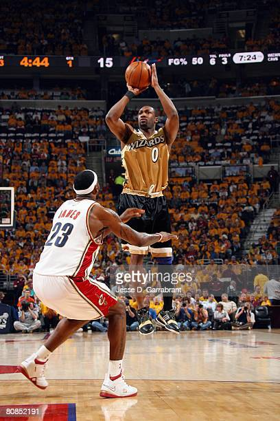 Gilbert Arenas of the Washington Wizards shoots a jump shot over LeBron James of the Cleveland Cavaliers in Game Two of the Eastern Conference...