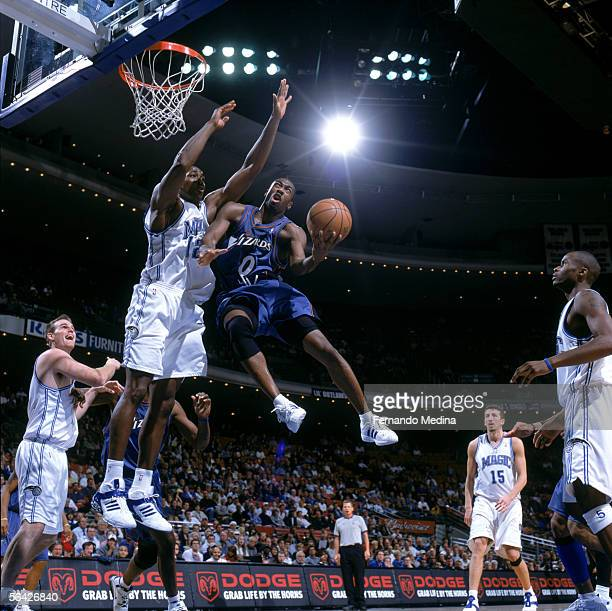 Gilbert Arenas of the Washington Wizards shoots against Dwight Howard of the Orlando Magic during the game at the TD Waterhouse in Orlando Florida on...