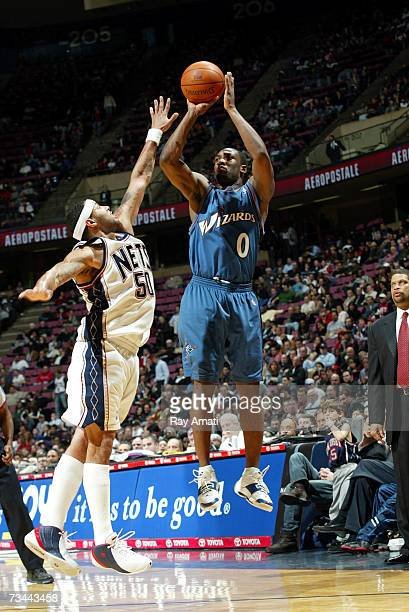 Gilbert Arenas of the Washington Wizards shoots against Eddie House of the New Jersey Nets on February 27 2007 at Continental Airlines Arena in East...