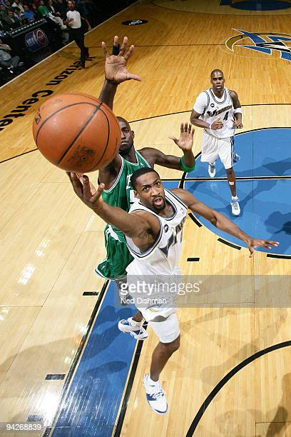 Gilbert Arenas of the Washington Wizards shoots against Kevin Garnett of the Boston Celtics at the Verizon Center on December 10 2009 in Washington...
