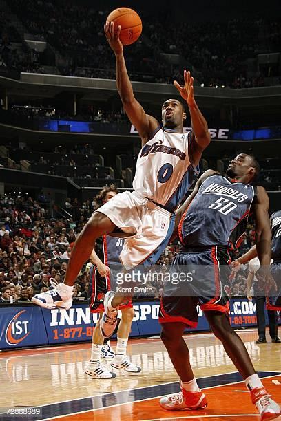 Gilbert Arenas of the Washington Wizards shoots over Emeka Okafor of the Charlotte Bobcats on December 27 2006 at the Charlotte Bobcats Arena in...
