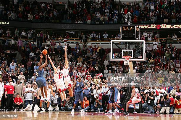 Gilbert Arenas of the Washington Wizards shoots the game winning shot over Kirk Hinrich and Tyson Chandler of the Chicago Bulls in Game five of the...