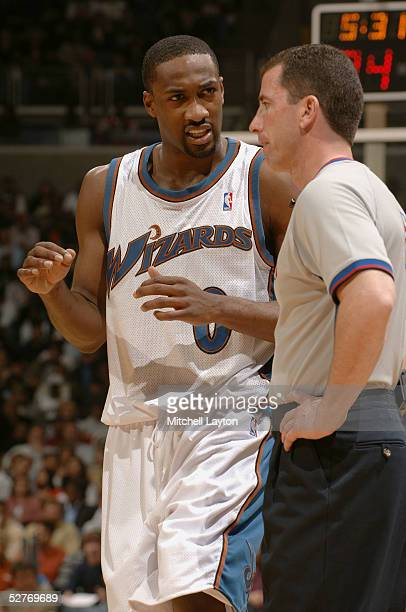 Gilbert Arenas of the Washington Wizards talks to referee Tim Donaghy during the game against the Chicago Bulls on April 13th, 2005 at the MCI Center...