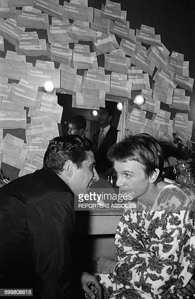 Gilbert Bécaud Congratulates Singer Claude François At the Olympia Music Hall in Paris France on September 26 1964