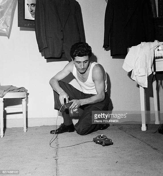 Gilbert Becaud in his dressig room at the Olympia music hall